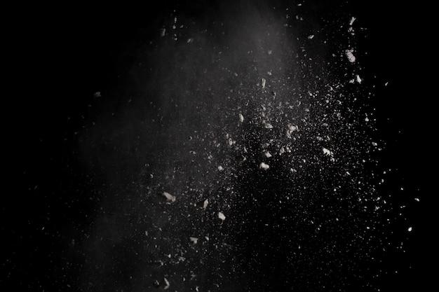 White powder explosion on black background. Premium Photo