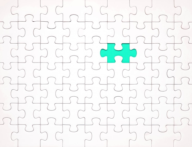White puzzle pieces on blue background. background for content Premium Photo