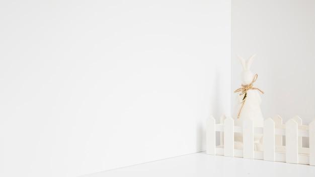 White rabbit figurine in fence Free Photo