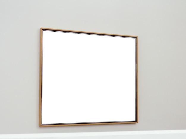 壁に茶色のフレームが取り付けられた白い長方形の表面 無料写真