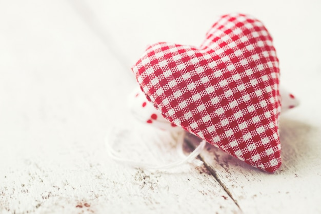 White and red checkered heart shaped teddy Free Photo