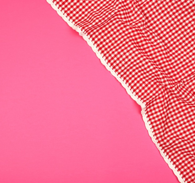 White red checkered kitchen towel on a pink background Premium Photo