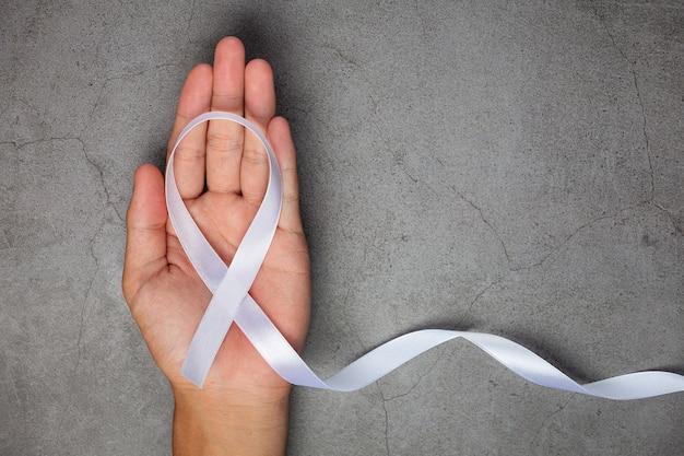 White ribbon symbol of peace international day of non violence. Free Photo