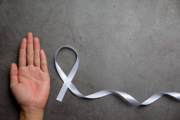 White ribbon symbol of peace international day of non violence. Free Photo