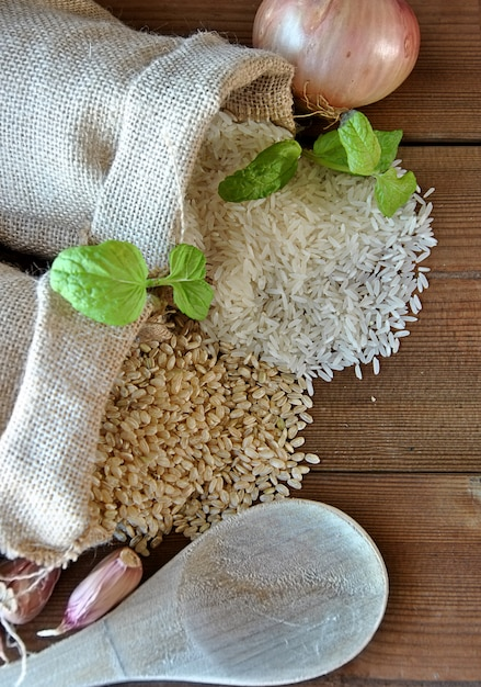 White rice and brown rice in canvas bags Premium Photo
