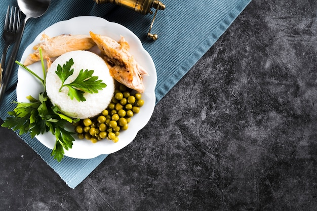 White rice with chicken breast and peas Free Photo