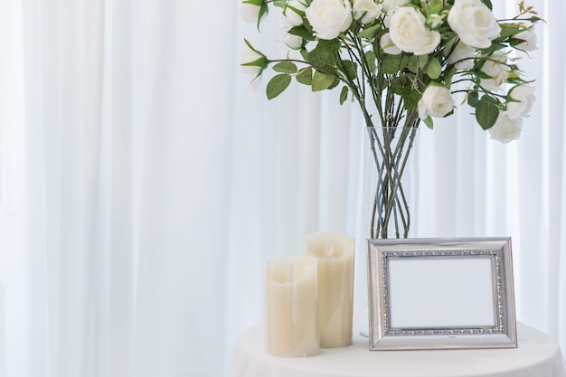 White rose with candle wedding beautiful photo frame love home decoration or wedding background Premium Photo