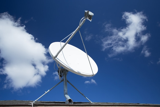 White satellite dish with blue sky Premium Photo