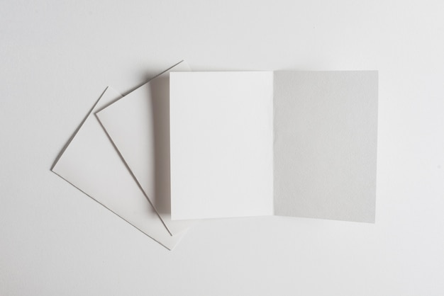 White sheet of papers on white backdrop Free Photo