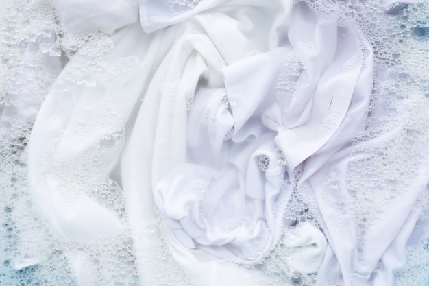 White shirt soak in powder detergent water dissolution. laundry concept Premium Photo