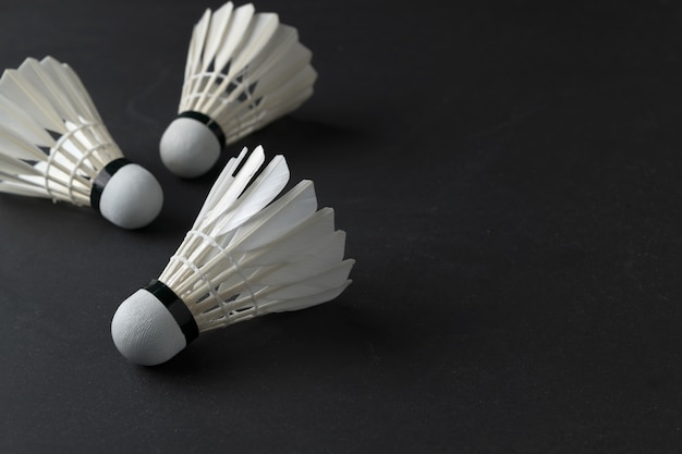 White shuttlecocks on black background.sport concept, concept winner, copy space image for your text Premium Photo