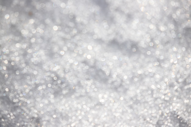 White silvery texture of defocused snow. bright spotted bokeh. Premium Photo