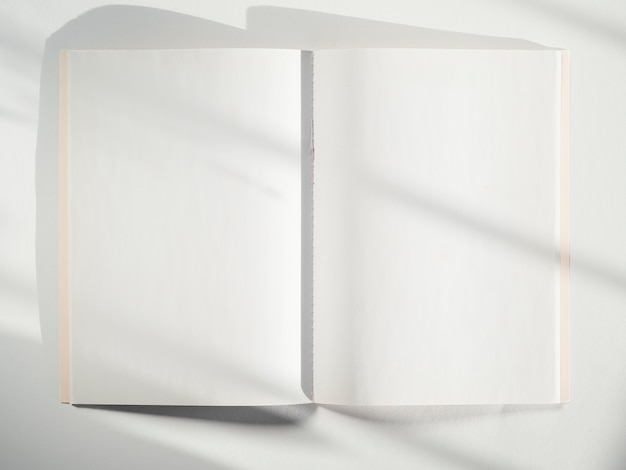 A white sketch book on a white background with shadows Free Photo