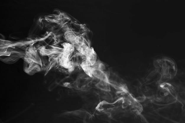 White smoke effect on the black background Free Photo