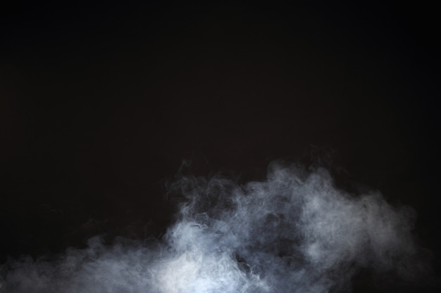 White smoke and fog on black background, abstract smoke clouds Premium Photo