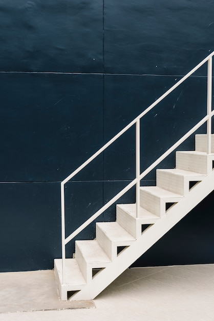 White staircase in a blue building Free Photo