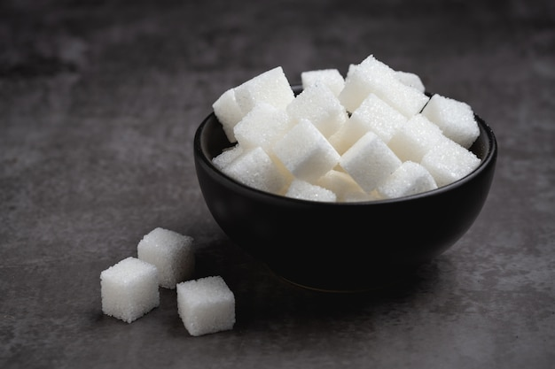 White sugar cubes in bowl on table. Free Photo
