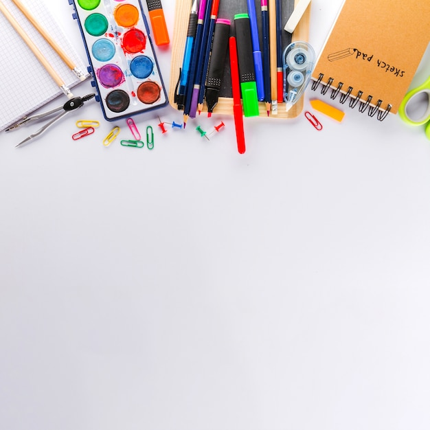 White surface and school supplies Free Photo