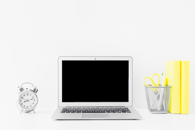 White table with laptop and notebooks Free Photo