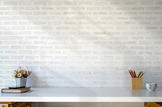 White table workspace with supplies and copy space. Premium Photo