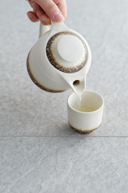 White teapot with glass and water Premium Photo