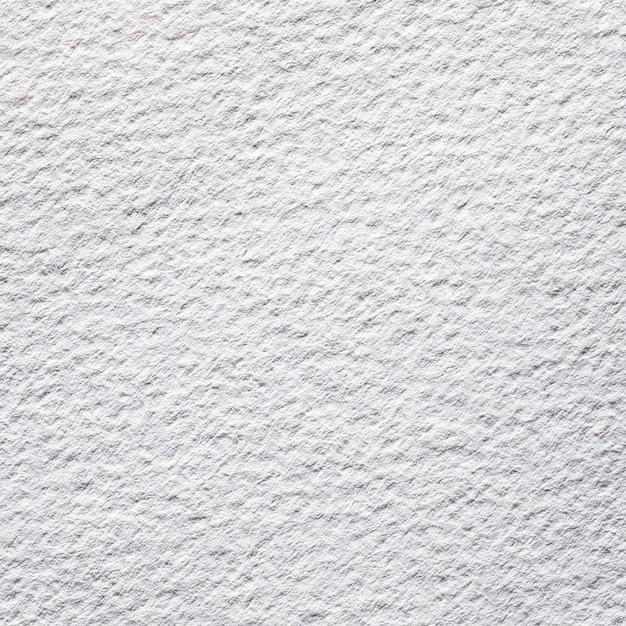 Белая текстурированная бумага крупным планом над видом Premium Фотографии