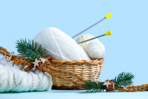 knitting needles and a white knitted