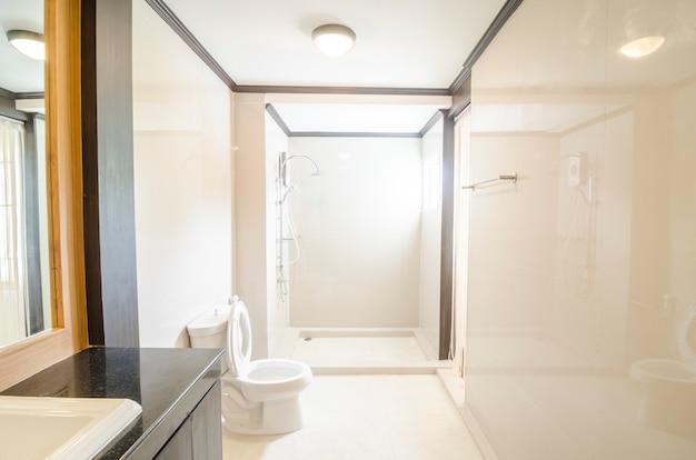 White toilet bowl in a bathroom Premium Photo