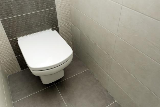 White toilet bowl in modern bathroom Premium Photo