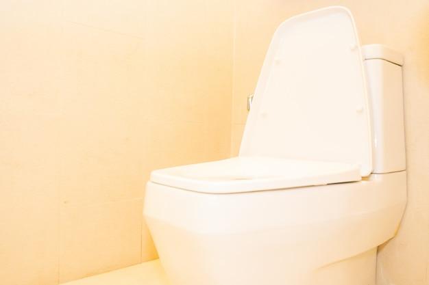 White toilet bowl seat decoration in bathroom Free Photo