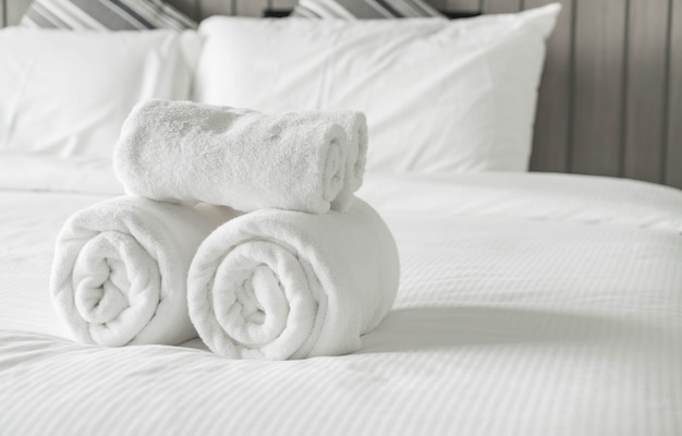 White towel on bed decoration in bedroom interior Free Photo