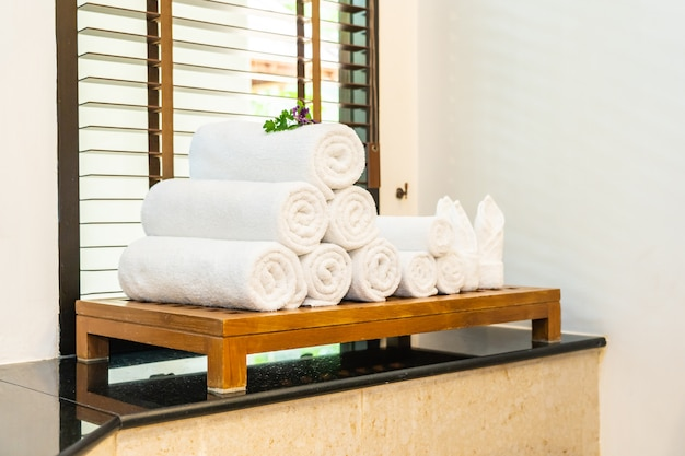 White towel on table in bathroom for take a bath or shower Free Photo