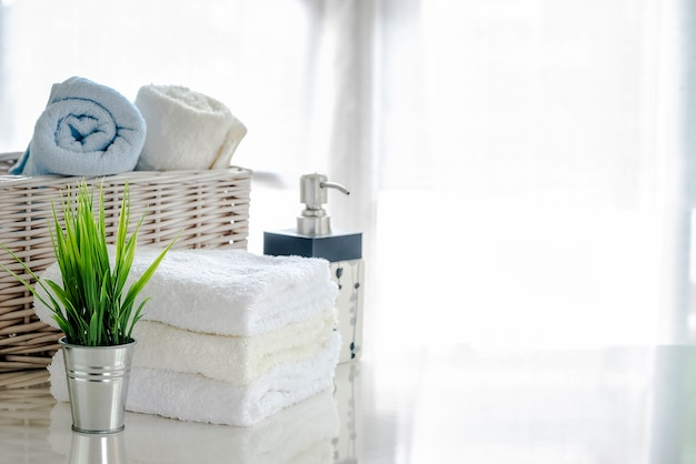 White towels on white table with copy space on bright room background Premium Photo