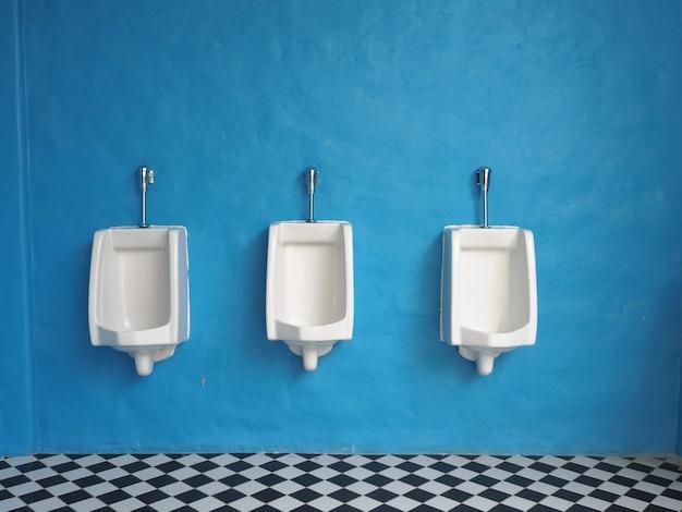 White urinals in mens bathroom Premium Photo