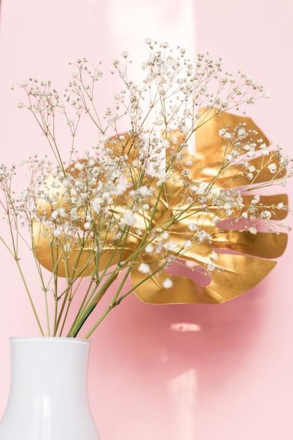 home decor silk floral arrangement floral decor tropical.htm white vase with golden tropical leaf and gypsophila flowers  white vase with golden tropical leaf