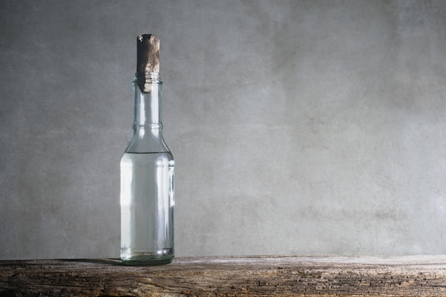 White vinegar bottle on wood table. Premium Photo