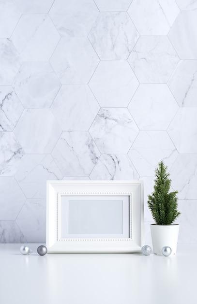 White vintage photo frame with christmas tree, pine cone and decor xmas ball on white table Premium Photo