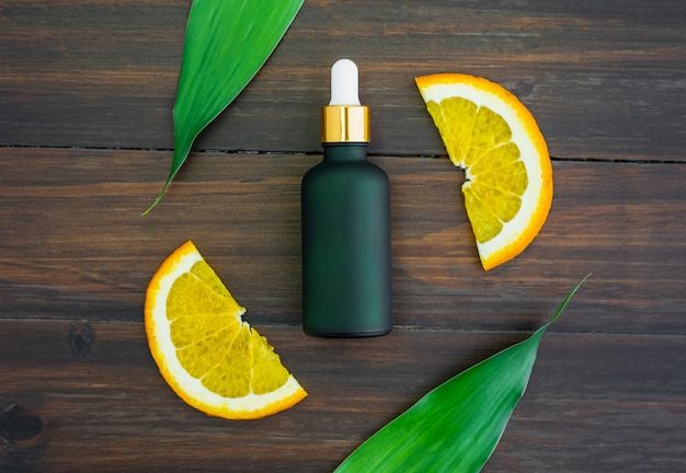 White vitamin c bottle and oil made from orange fruit extract, mockup of beauty product brand. Premium Photo