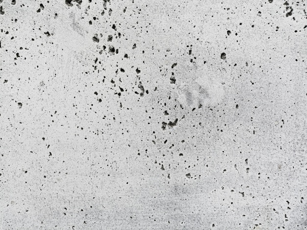 White wall texture with holes Free Photo
