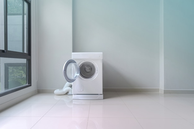 White washing machine in laundry room Premium Photo