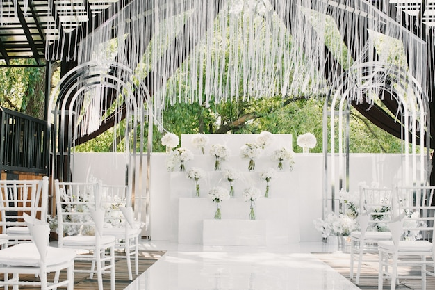 White wedding decorated with flowers Free Photo