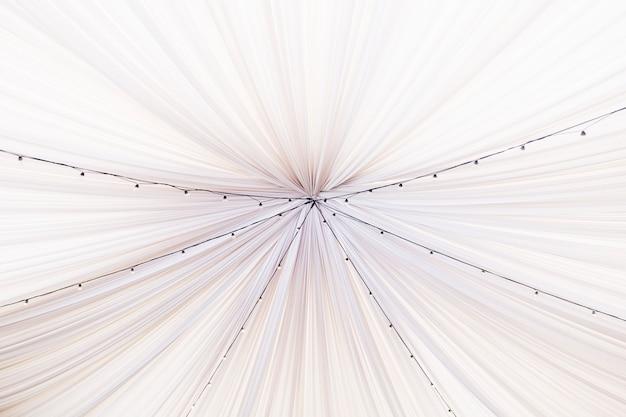 White wedding tent with decorative bulbs. interior of the restaurant Premium Photo