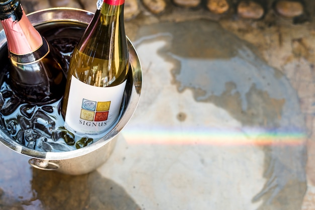White wine in ice bucket Premium Photo