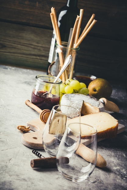 White wine with charcuterie assortment on the stone background Premium Photo