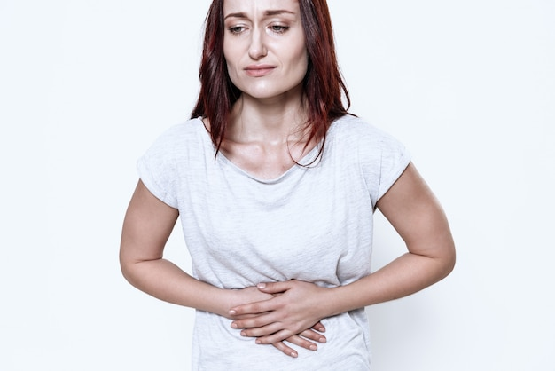 A white woman has a stomach ache. Premium Photo
