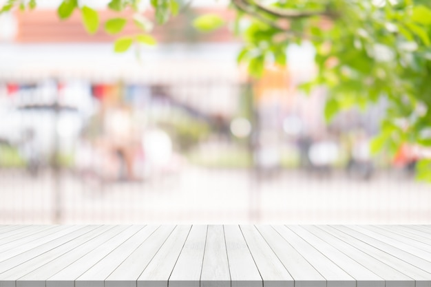 White wood table top on blurred background from garden Premium Photo