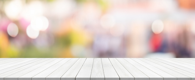 White wood table top on blurred background from shopping mall Premium Photo
