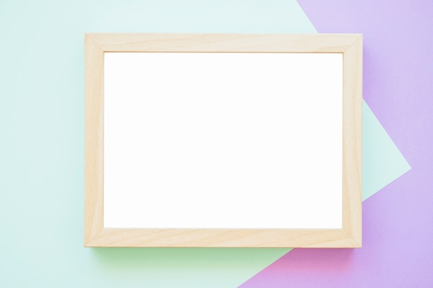 White wooden frame on green and purple backdrop