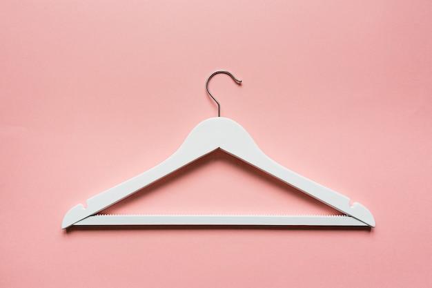 White wooden hanger on pink Premium Photo