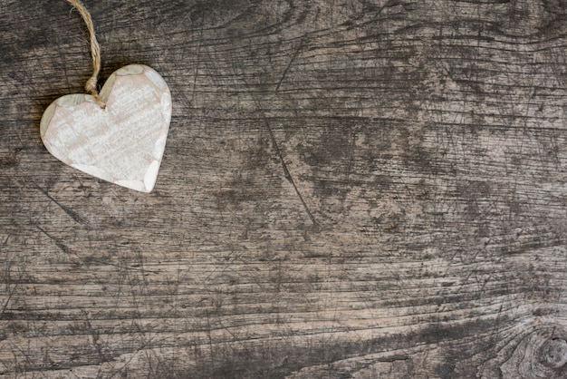 white wooden heart on rustic table Free Photo